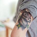 Татуировки на руках олень